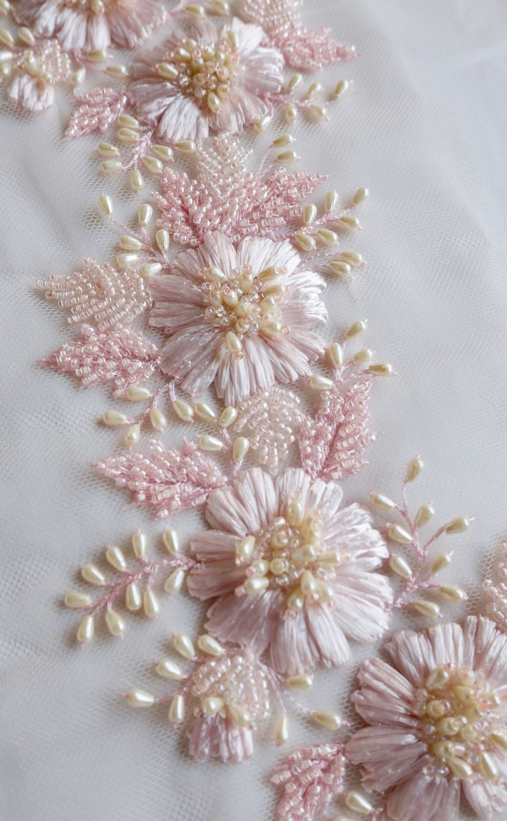 Hand-embroidered trim with pink raffia flowers and drop-shaped pearls