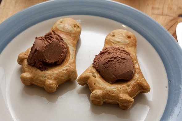 cute penguin waffles topped with chocolate ice cream