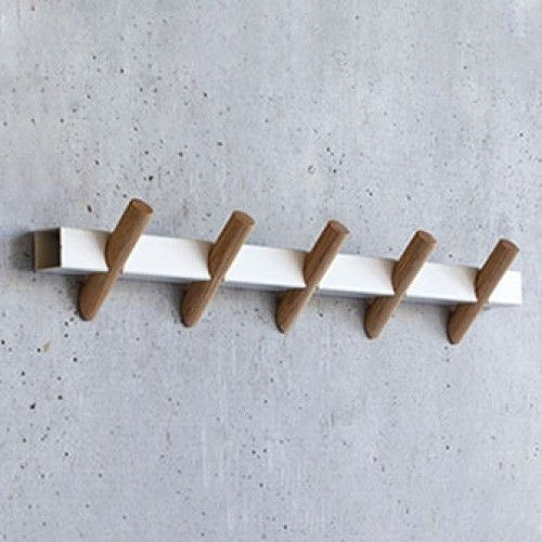 """Designed by Faudet-Harrison for SCP, the Crosscut Coat Hooks are a simple and stylish means for hanging coats, hats, scarves, and other accessories. Made from a single piece of laser-cut rectangular steel and five cylindrical oak hooks, the wall-mounted rack can be used in an entryway, bedroom, or even a kitchen space as a quick way to eliminate clutter. Dimensions: 23.62""""L x 3.54""""W x 3.54""""H Materials: steel and wood Year: 2013 Made in: United Kingdom"""