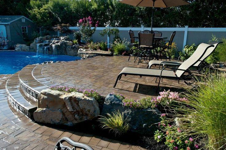 Raised Patios Flower Beds And Waterfall Make Backyard