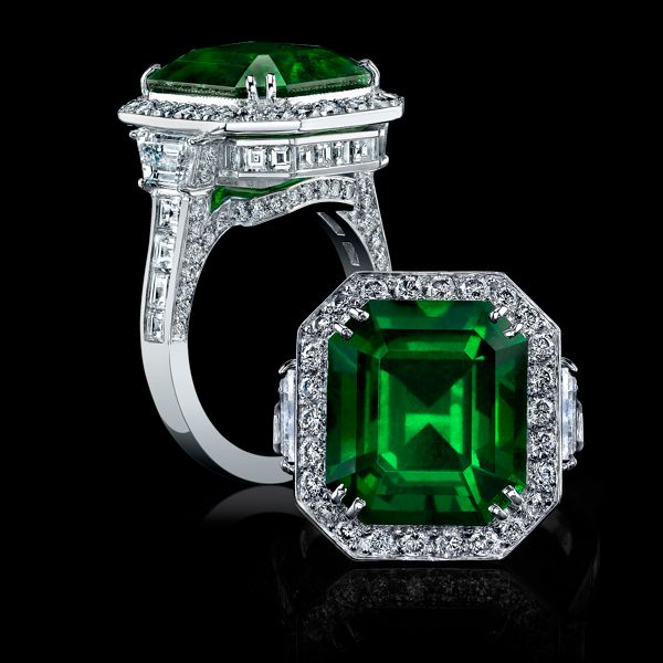 A stunning 7.88ct emerald cut green emerald is certified by Dr. A. Peretti of the Gem Research Lab as Colombian in origin. Colombia is a valued source for very rare, high quality emeralds.  Held in an intricate setting of handcrafted platinum, this emerald is accented with channel set micro pave diamonds and square shank diamonds totaling 3.06cts tw of white diamonds.