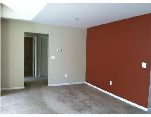 Red accent wall dining