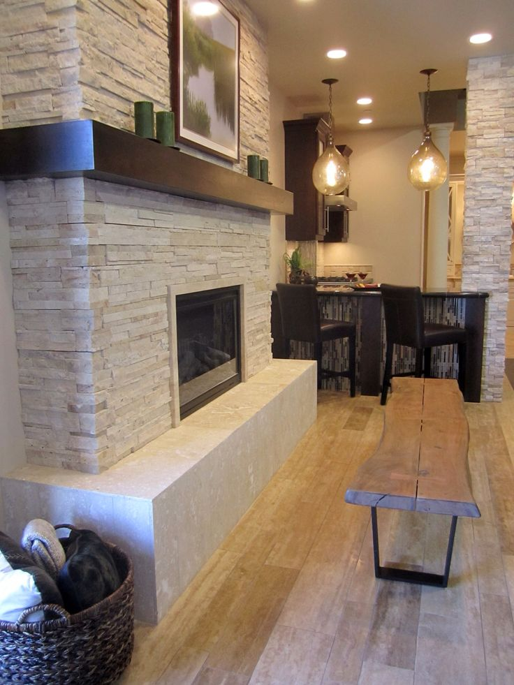 LOVE THE MANTLE ABOVE FIREPLACE! A rustic but modern fireplace. #thetileshop