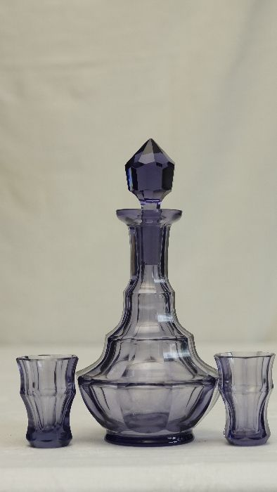 Interesting amethyst glass Art Deco carafe and pair of glasses set