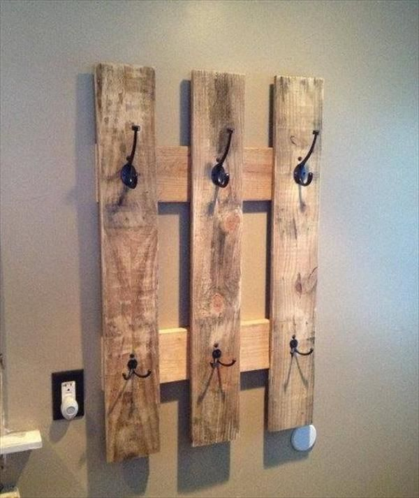 The perfect piece of pallet decor for your home. Keep it rustic or stain the coat hanger for a more modern look.