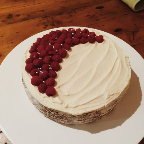 White chocolate and raspberry mud cake with white chocolate ganache and fresh raspberries