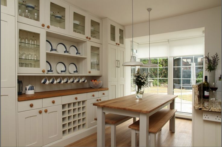 CORNWALL: A country kitchen by the sea . . . delightful cream and natural wood design set against spectacular scenery - The House in The Sea, Newquay, Cornwall. From www.uniquehomestays.com.