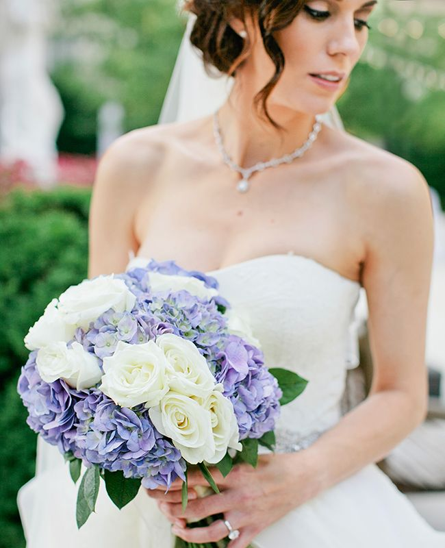 White roses and blue hydrangea bridal bouquet | Kristyn Hogan | blog.theknot.com