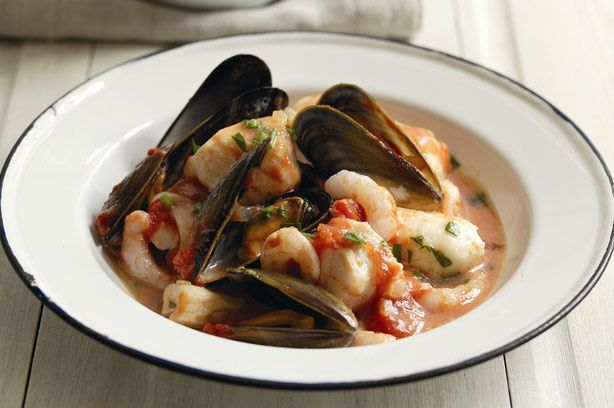 Monkfish stew tsp olive oil 1 large onion, peeled and chopped 2 garlic cloves, peeled and chopped Bay leaf Thyme, rosemary and oregano 1 sprig of each Fish stock 350ml (12fl oz) Dry white wine 150ml (1/4pt) Firm white fish fillets, e.g. cod, halibut or monkfish 450g (1lb) Fresh prepared mussels 450g (1lb) Chopped tomatoes 400g can Peeled prawns 225g (8oz), thawed if frozen Chopped parsley 2tbsp