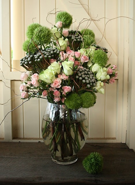 How to make this floral arrangement of Spring flowers...I kind of think that all homes should have fresh flowers hanging about somewhere and I love all the green in this arrangement!    10 mini pink rose sprays  12 soft lime roses  10 pixi (pom-pom) carnations (I'd switch for peonies)  5 stems of Brunei nut: