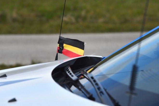 Belgian flag at half mast during Dwars door Vlaanderen