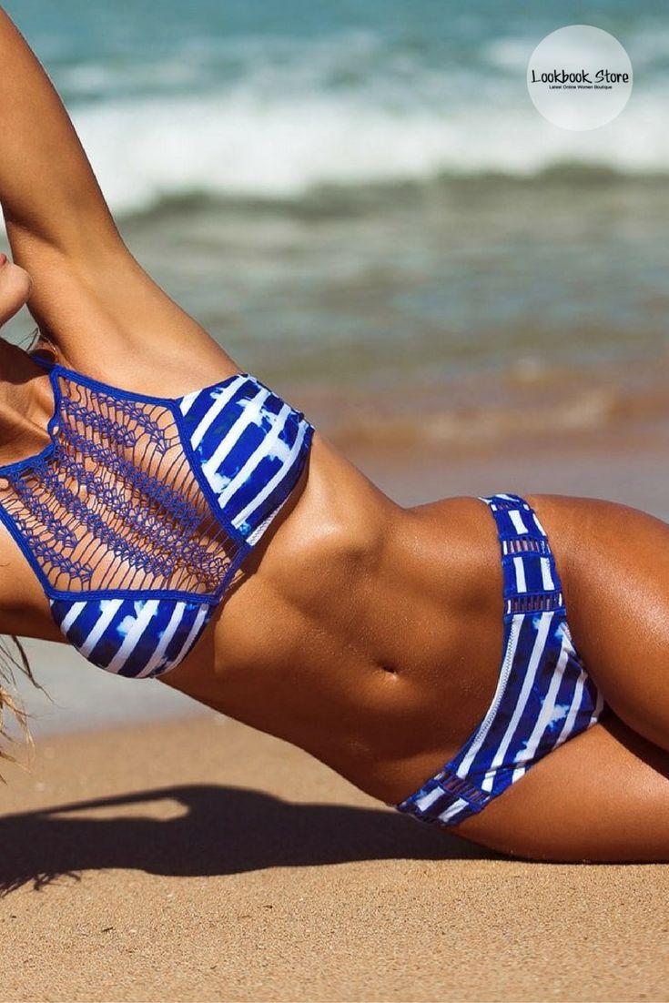 Swimwear // Get on the beach by wearing something fun and funky like this inked blue halter brazilian bikini set.