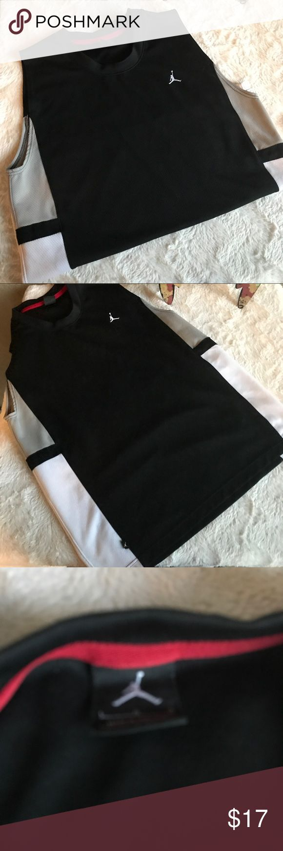 Nike Air Jordan JUMPMAN Sleeveless Jersey Tank Condition: Preowned - Excellent Condition! Shirt is free from holes, stains, snags or missing tags.  Description: * Jumpman * Air Jordan jersey tank top / sleeveless shirt * Black body; mostly white side panels with Gray   * Embroidered logo on front * 100% Polyester  * Soft on the inside * Slits at the bottom sides * Machine washable Air Jordan Shirts Tank Tops
