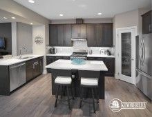 Kitchen, with eat-up island and peninsula. Quartz counters, stainless steel appliances. Luxury 3 bedroom townhomes. The Intrigue model, by Kimberley Communities.