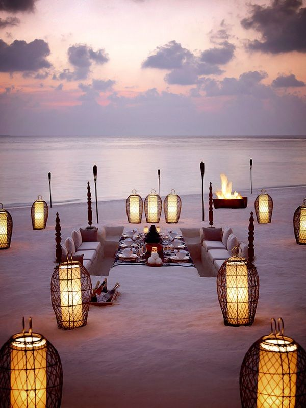 Beach dinner in the Maldives (with chairs dug into the sand!)