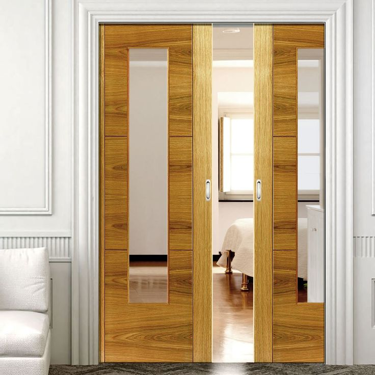 Double Pocket Brisa Mistral Oak sliding door system in three size widths with clear glass. #pocketdoors #glazeddoors #'slidingdoors