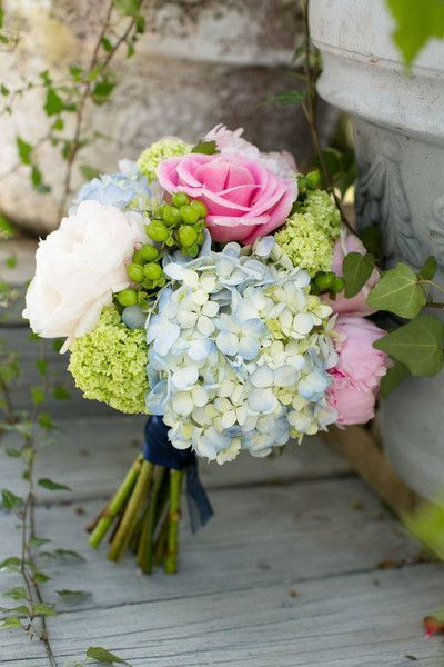 blue hydrangea wedding bouquet with pink roses