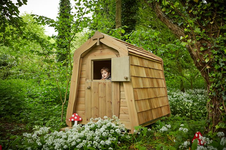 Wooden hidey hole hobbit house with cedar shingles