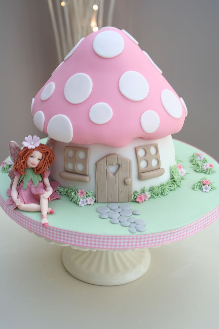 This cake makes me want to make a fairytale toadstool house cake
