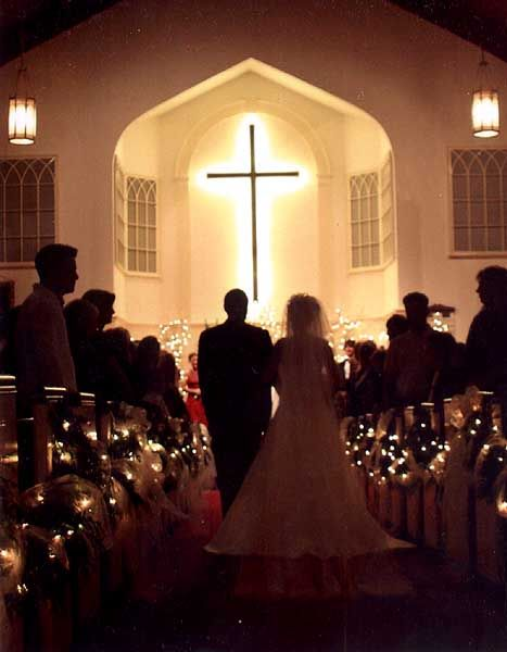 28 best christmas church decorations images on pinterest church garland with christmas lights down the isle beautiful with the dim lights perfect for christmas wedding in the evening junglespirit Image collections