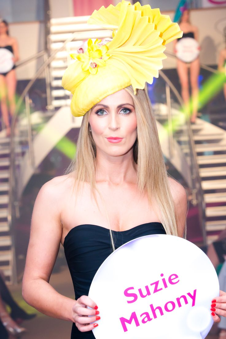 Dramatic yellow Suzie Mahony hat at Glamour at the g - June 2014.