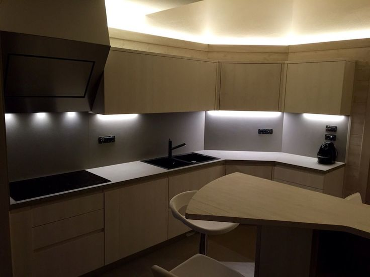 The kitchen in light oak and fir wood furniture, treated with water-based varnishes offering a full chromatic homogenity.