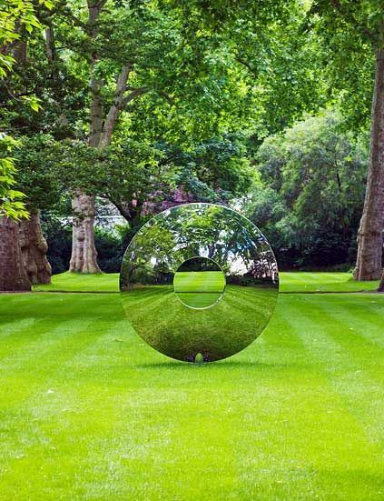 Torus - By David Harber  A beautifully formed mirror polished stainless steel elliptical portal that plays with light and reflections to mislead the eye and stimulate the mind.