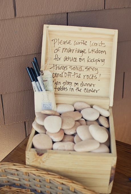 """Have guests write a piece of wedding advice on a stone to keep the marriage """"off the rocks!""""   Brides.com"""