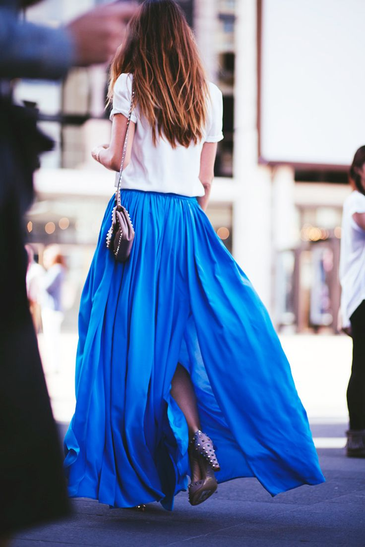 Royal Blue Pleated Maxi Skirt, Tee Shirt, Long Brown Ombre Hair, Small Side Purse, Heels.