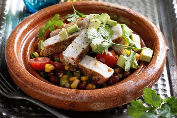 Mexican corn and bean salad with grilled pork