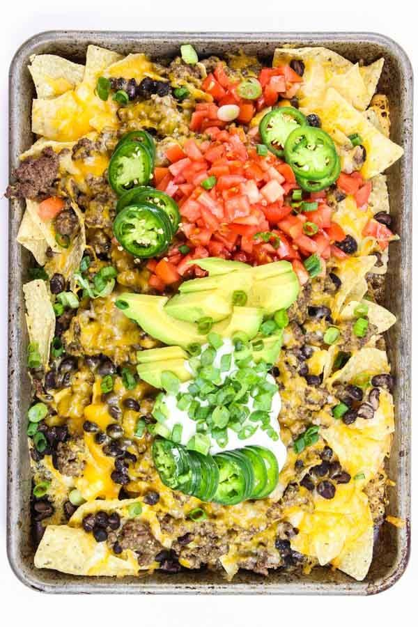 Super easy, cheesy, sheet-pan Mexican Nachos in the oven!!