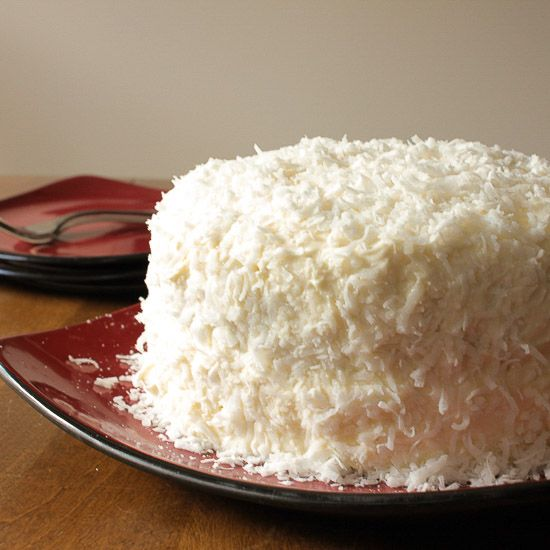 Coconut Cake, a delicious soft, moist cake with a creamy cream cheese frosting. Topped with coconut flakes, a perfect Christmas dessert /anitalianinmykitchen.com