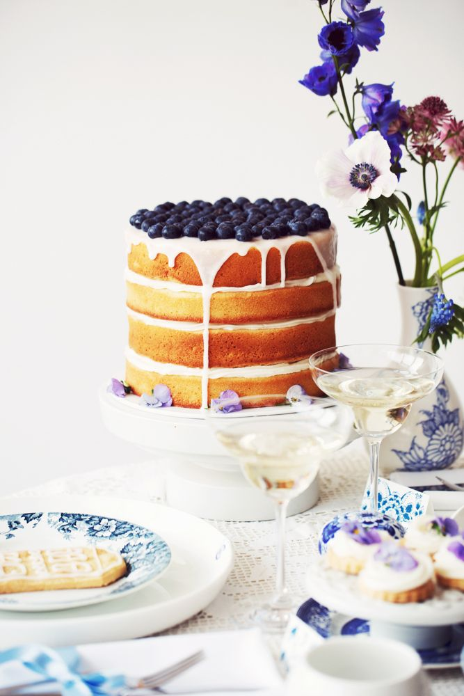 Naked wedding cake decorated with blue berries. A flavor that will never get old!