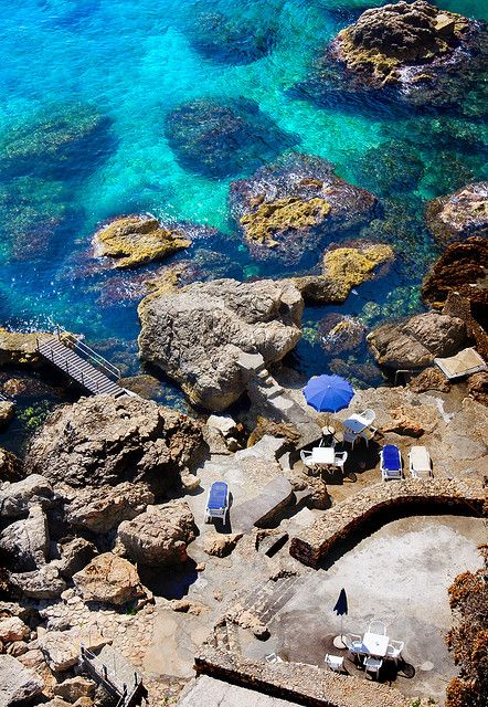 Taormina, Sicily, Italy this truly is what the water looks like in Italy, and in Spain also. I loved swimming there...I didnt need goggles to see to the bottom, all you had to do was look down :)