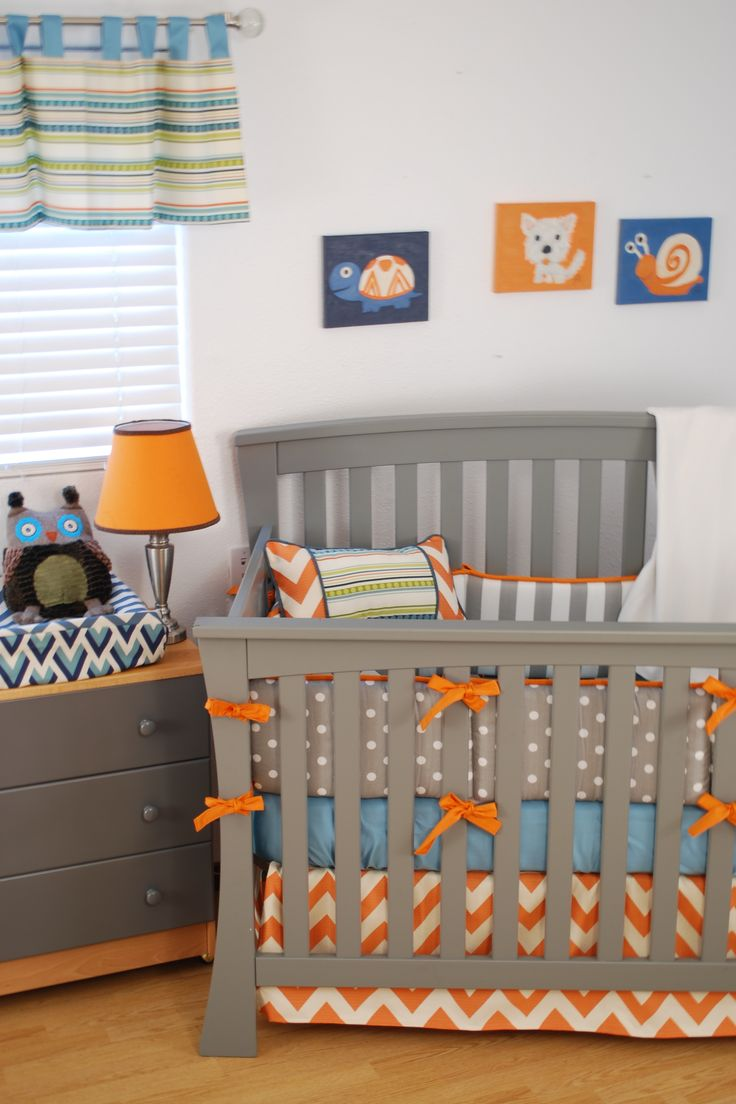 bright crib bedding pairing grey fabrics with orange chevron grey polka dots aqua and stripes in the nursery