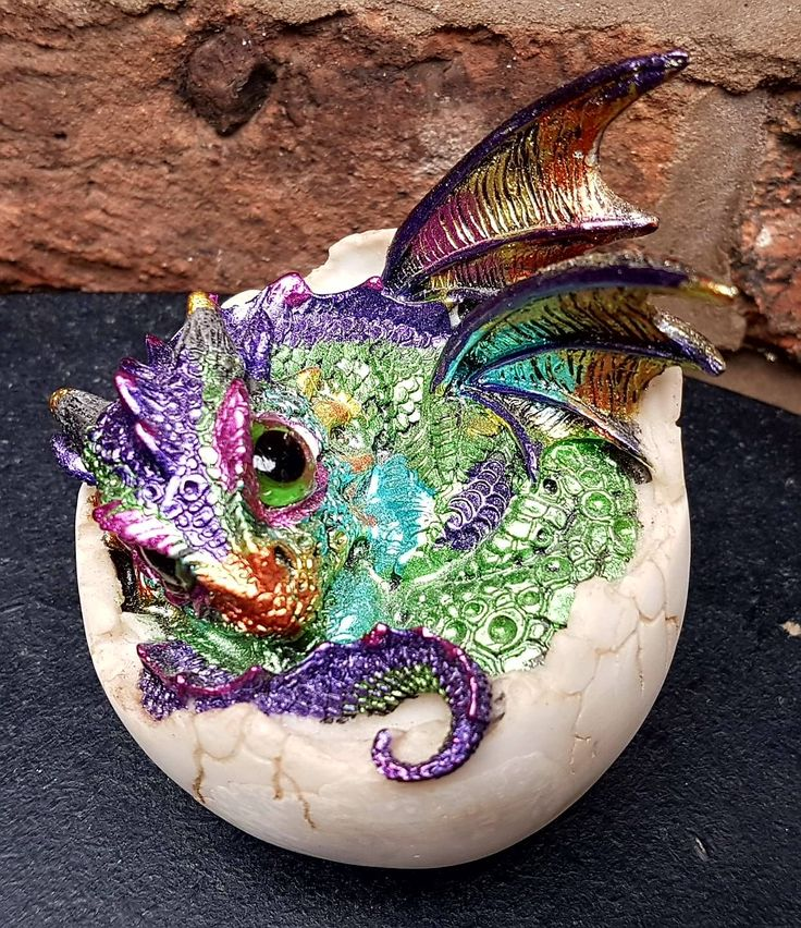 Kazon  £12.00  Nemesis Now is pleased to bring you this magical Dragon figurine, available as part of their Alator high-value alternative giftware range. Freshly hatched, just beginning to emerge from the egg, this iridescent purple and green dragon cautiously stretches its wings. It fixes you with a green eye, as if trying to judge if you're a parent or a first meal. The bulk of the body remains protected by the eggshell, but cracks are rapidly forming as the dragon breaks free.