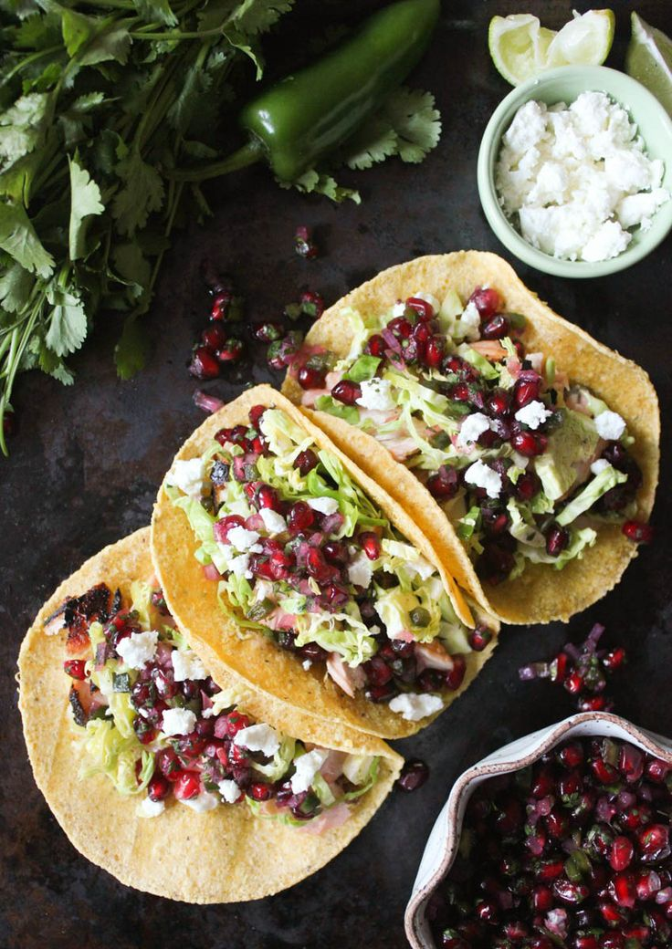Grilled Salmon Tacos with Pomegranate-Jalapeño Salsa. These nutrient-packed tacos are the healthiest (and most delicious) way to celebrate Taco Tuesday. via www.domesticate-me.com