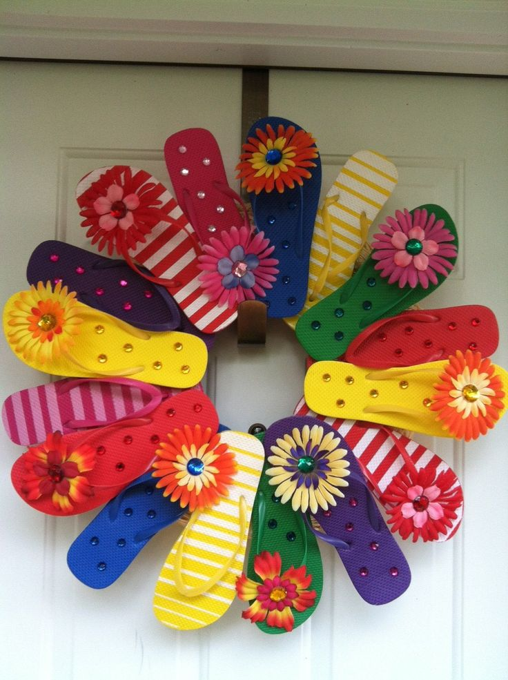 Actually saw this done-  Used 5 flip flops and ribbons on hers- Flip Flop Wreath