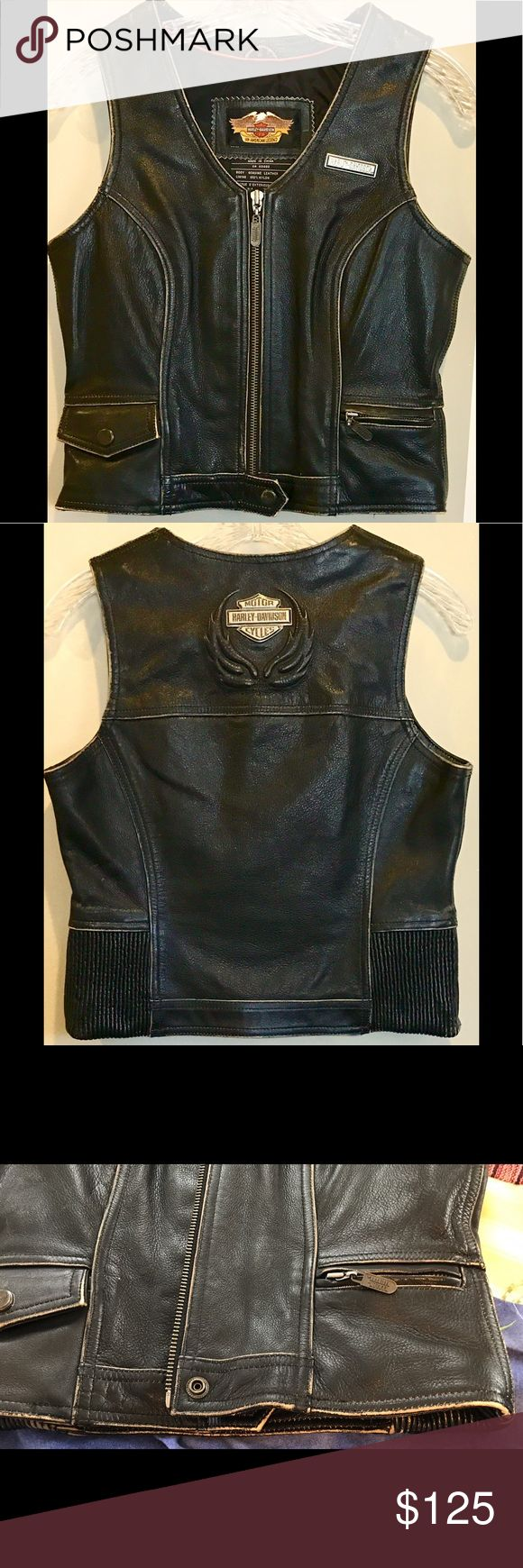 "HARLEY-DAVIDSON GENUINE LEATHER Zip Front VEST! S This is an AMAZING,  Beautiful, Heavy-duty HARLEY-DAVIDSON GENUINE LEATHER, In a ""Distressed Dark Brown"" Zip Up Vest! Women's Size Small. In GREAT Condition, Pre-Loved, but was not worn much. All zippers & Snaps work great. A Great-Fitting Vest, it never had time to fit to my shape. Nylon Lined, Rugged. AUTHENTIC H-D Vest, a Beauty! At upper center back, H-D Metal Logo with Leather Flames surrounding it. If you would like more PICS, Just Ask…"