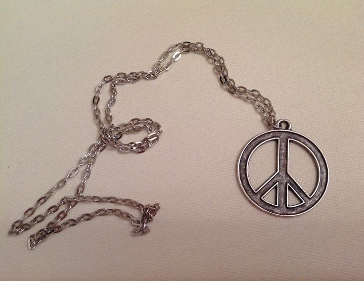 A personal favorite from my Etsy shop https://www.etsy.com/listing/251760085/silver-peace-sign-necklacefreedom-sign