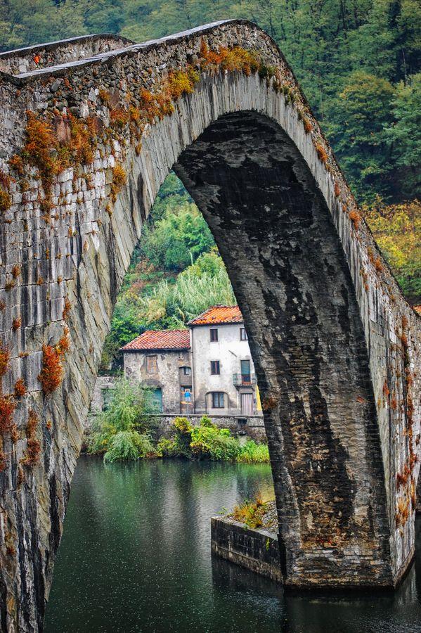 """""""Ponte della Maddalena"""" is a bridge crossing the Serchio river near the town of Borgo a Mozzano, Italy"""