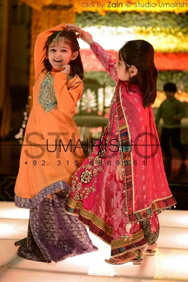 Pakistani little girls enjoying at wedding.