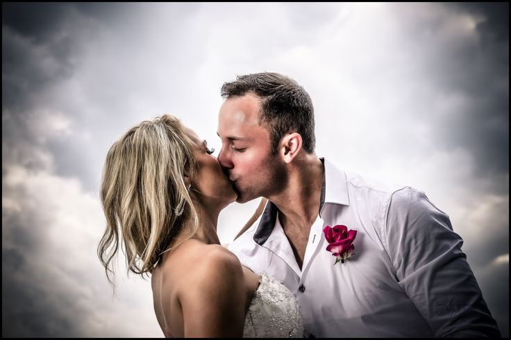 Adam and Crystals first kiss while just being announced husband and wife.   Wedding Photographer Kent Leckie