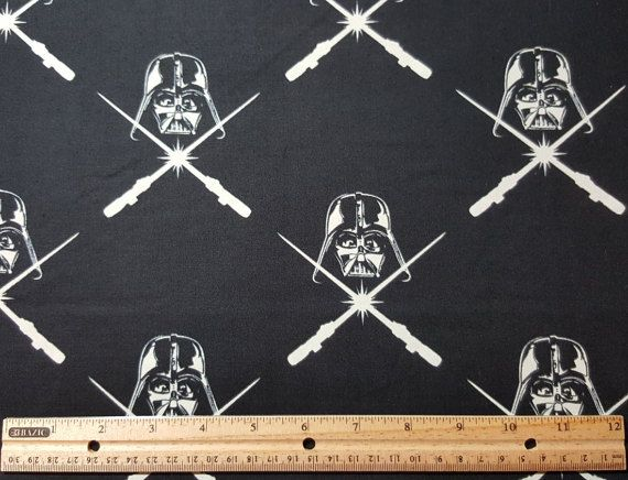 Great Glow-in-the-Dark Darkth Vader Star Wars fabric. Darth Vader helmet with crossing light sabers. Black background, glow in the…