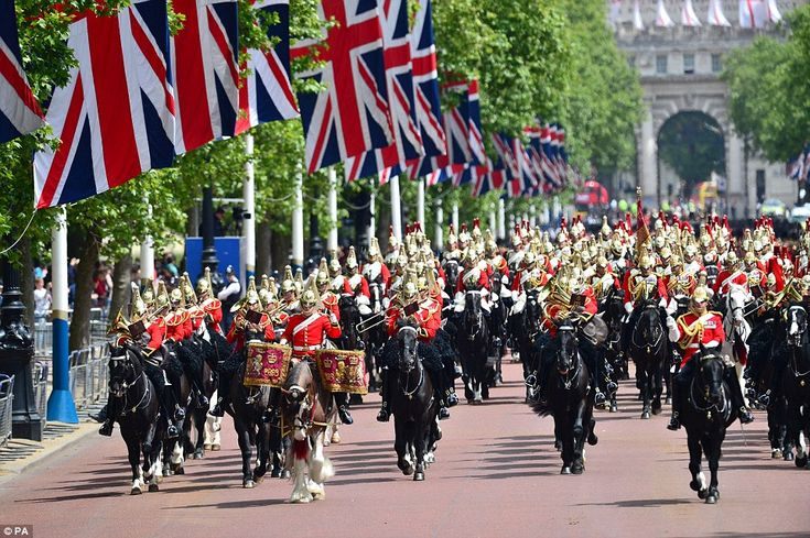 Dressed in full military regalia, infantry members - both foot guards and horse guards - m...