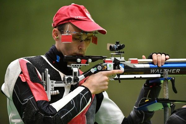 Serbia's Milenko Sebic competes during the 10m Air Rifle Men's at the Olympic Shooting Centre in Rio de Janeiro on August 8, 2016, during the Rio 2016 Olympic Games. / AFP / PASCAL GUYOT