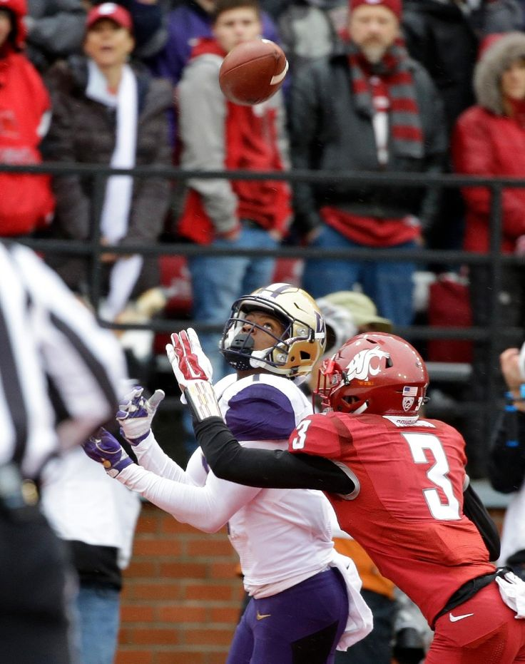 Washington wide receiver John Ross, left, eyes the pass he caught for a touchdown ahead of coverage from Washington State cornerback Darrien Molton (3) in the first half of an NCAA college football game, Friday, Nov. 25, 2016, in Pullman, Wash. (AP Photo/Ted S. Warren)