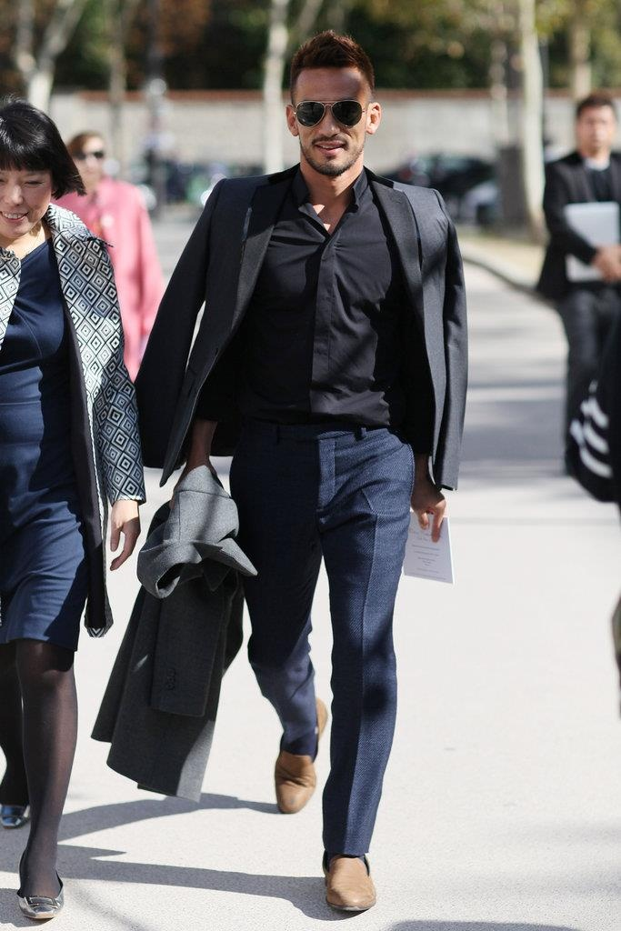 Hidetoshi Nakata. Navy blue and black  on black combo. With Grey coat. Classy.