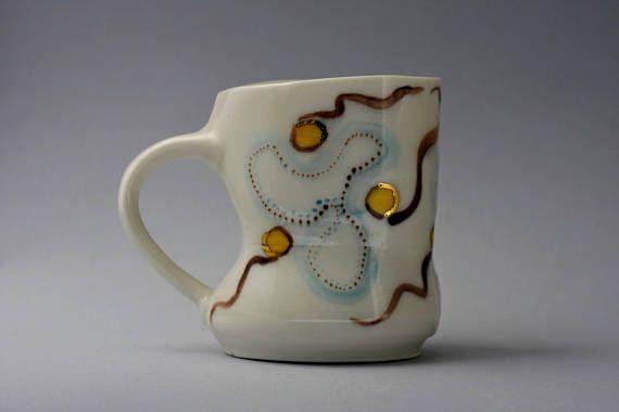 Porcelain wheel thrown-hand painted mug aprox 10oz. With 23k