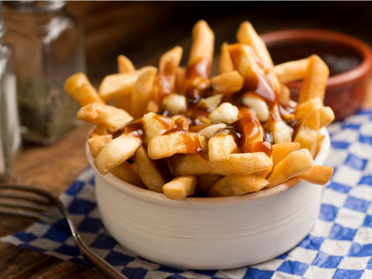 Head to La Banquise in Montreal for a scrumptious plate of poutine: crisp french fries that have been smothered in brown gravy and cheese curds.